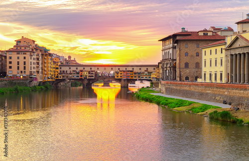 Poster famous bridge Ponte Vecchio over Arno river at sunset, Florence, Italy
