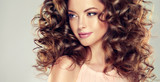 Beautiful model girl with  wavy  hairstyle  . Brunette woman with long  curly hair - 139356607