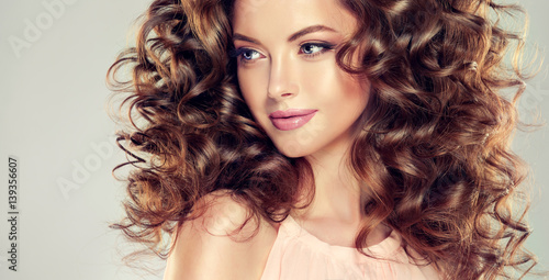 Plakat Beautiful model girl with  wavy  hairstyle
