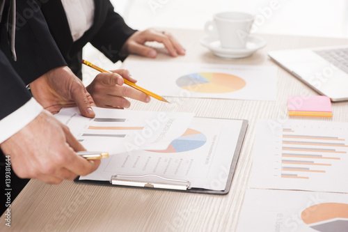 Business people working at meeting with charts