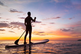 paddleboard on the beach at sunset, paddle standing in Thailand - 139382091