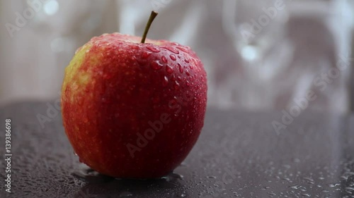 Fresh apple with water drops