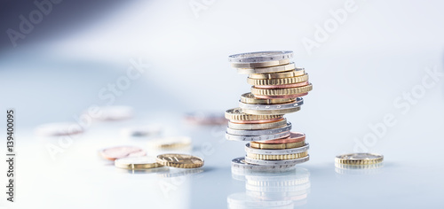 Leinwanddruck Bild Euro coins. Euro money. Euro currency.Coins stacked on each other in different positions. Money concept.