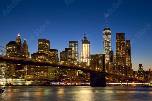 Brooklyn Bridge and New York City Manhattan skyline at dusk