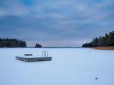 Jetty on frozen lake.