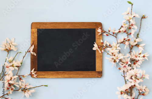 spring white cherry blossoms tree and blackboard Poster