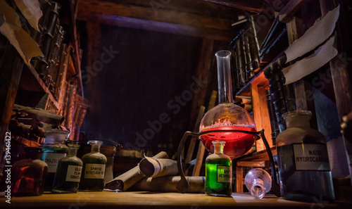 Medieval alchemist laboratory with various kind of flasks in Prague, czech republic