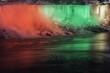 Night scene of Niagara Falls USA american, beautifully illuminated in red, green and yellow, winter scene