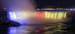 The Canadian Niagara Falls beautifully illuminated at night in blue, red and yellow, winter tourism scene