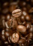 Macro photo of flying coffee beans. All beans in focus. - 139500280