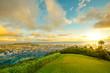 Tantalus Lookout at sunset, Puu Ualakaa State Park Honolulu. Tourists on panoramic city,Waikiki Beach and Diamond Head. Waikiki skyline Oahu Hawaii, United States. Vacation and travel concept.