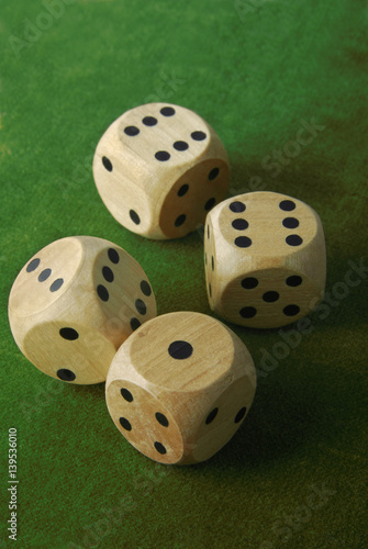 closeup of the dices on green table плакат