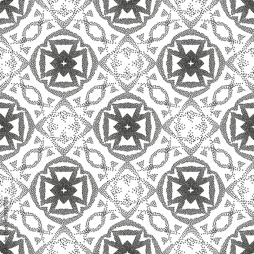 Seamless monochrome ethnic pattern of dots. A pockmarked background of geometric shapes and stylized plant elements.
