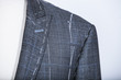 Details of a tailored suit jacket