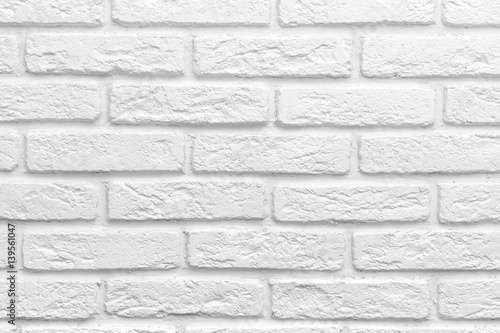 Fototapeta Abstract weathered texture stained old stucco light gray white brick wall background, grungy blocks of stonework technology color horizontal architecture wallpaper