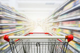 Supermarket aisle with empty red shopping cart - 139574666