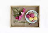 Cookies macaroni served on a plate on wooden tray with fresh roses