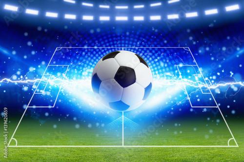 Foto op Aluminium Bol Soccer ball, bright blue lightning, green football field with layout