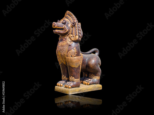 Poster Asian Imperial Lion Statue, Isolated on black background