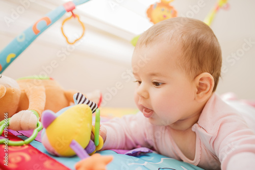 Cute baby playing with colorful toys