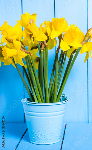 Spring easter background with daffodils bouquet in the bucket