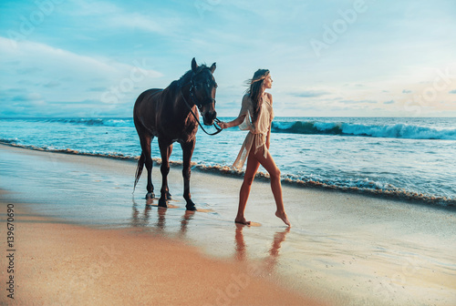 Fototapety, obrazy : Slim young lady walking with a horse pet