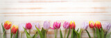 Fototapeta Kitchen - bouquet of tulips of spring flowers on old wooden board on holiday of Easter © Chepko Danil