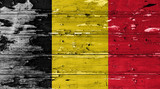 Belgium flag on wood texture background with old paint peels