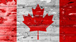 Canada flag on wood texture background with old paint peels