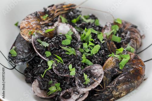 Black Venus rice with fish. Poster