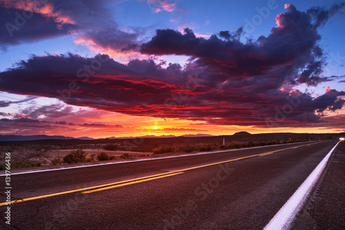 Sunset sky and road Poster
