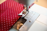 Red polka dot fabric on a sewing machine - 139790086