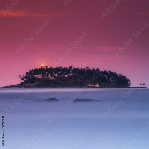 Foto op Canvas Crimson Sri Lanka. Lighthouse on an island Barberun off the coast Beruwala
