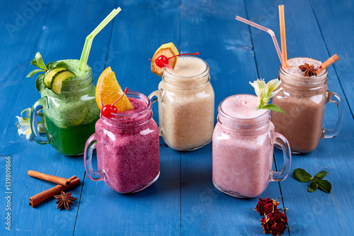 Variety of Fresh Healthy Paleo Smoothies and Cocktails in Rainbow Colors on Blue Poster