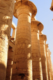 Ancient Egypt. The columns are decorated with carved hieroglyphs. Karnak Temple. Luxor. Thebes.