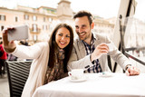 Young couple taking selfie in the restaurant in Rome, Italy - 139842649