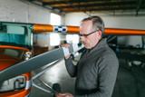 Flight instructor inspecting small Piper aircraft