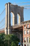 Brooklyn Bridge pillar in New York, warm light in a sunny day
