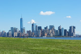 New York city skyline and green meadow, blue sky in a sunny day