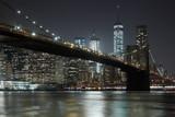 Brooklyn Bridge and New York city skyline illuminated at night - 139872232