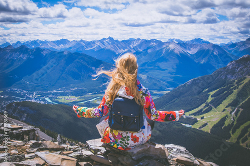 Woman on the top of the mountains