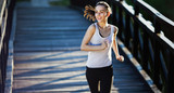 Sporty female jogger running and training outside