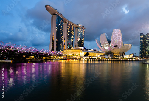 MARINA BAY, SINGAPORE - Mar 3, 2017: Singapore Art Science Museum light up in accordance to iLight Marina Bay- Asia's leading sustainable light art festival, held in the Marina Bay, Singapore Poster
