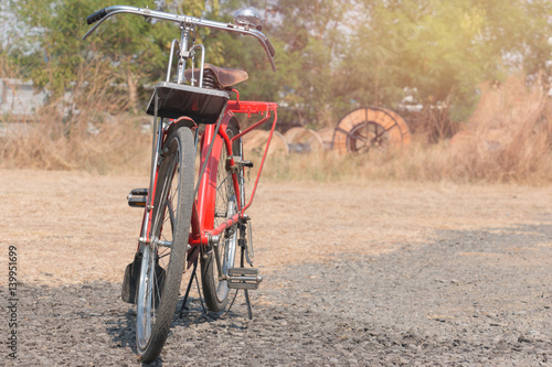 Foto op Canvas Scooter bicycle red classic vintage in former