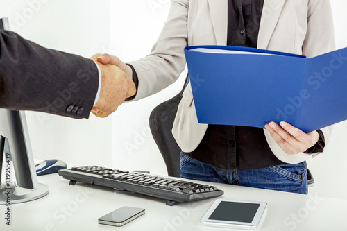 Poster Businesswoman with briefcase man shakes the hand