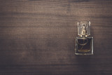 perfume bottle on the wooden background - 139985671