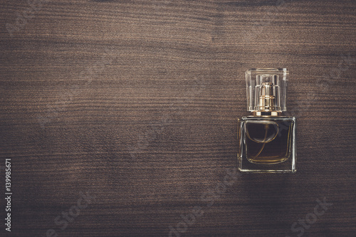 perfume bottle on the wooden background