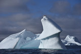 Huge iceberg with birds on the top