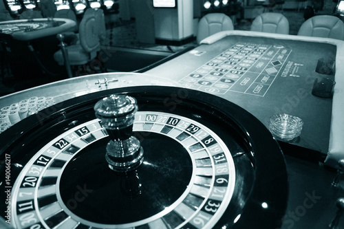 Roulette wheel in casino Poster