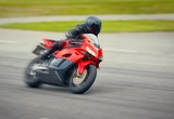 Fototapety Fast motorbike racing on the race track at high speed.